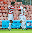 Hamilton's Martin Canning tries to get Darian MacKinnon to calm down as he receives his first yellow card.