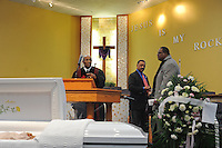 (L-r) The Reverends Roosevelt James, Jesse Jackson and Beauty Turner's nephew at the funeral of housing activist Beauty Turner, 51, a one-time resident of the Robert Taylor Homes who led the Beauty Turner Ghetto Bus Tour and received national recognition in publications such as The Wall Street Journal, at the Greater Harvest Missionary Baptist Church on South State Street in Chicago, Illinois on December 26, 2008.  Turner died of an aneurysm on December 18.
