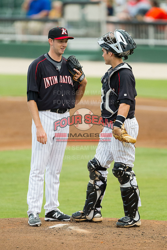 Kannapolis Intimidators relief pitcher Alex Powers (39) and catcher Brett Austin (10) have a chat on the mound during the game against the Delmarva Shorebirds at CMC-NorthEast Stadium on July 3, 2014 in Kannapolis, North Carolina.  The Shorebirds defeated the Intimidators 6-5. (Brian Westerholt/Four Seam Images)