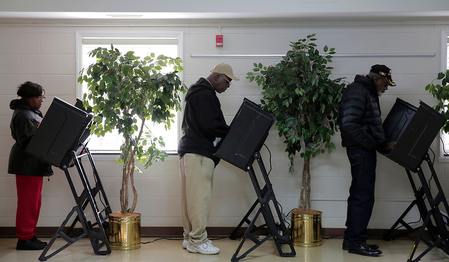 GREENSBORO, NC - NOVEMBER 4:   Voters cast their ballots at Trinity A.M.E. Zion Church in Greensboro, NC, on Tuesday, November 4, 2014.  (Photo by Ted Richardson/For The Washington Post)