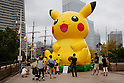 "Visitors take pictures of the big figure of Pikachu at the ""1000 Pikachu Outbreak! at Yokohama Minatomirai"" on August 09, 2014. 1000 Pikachu performed at different areas of Minatomirai in Yokohama during the summer vacation event from August 9 to 17.  (Photo by Rodrigo Reyes Marin/AFLO)"