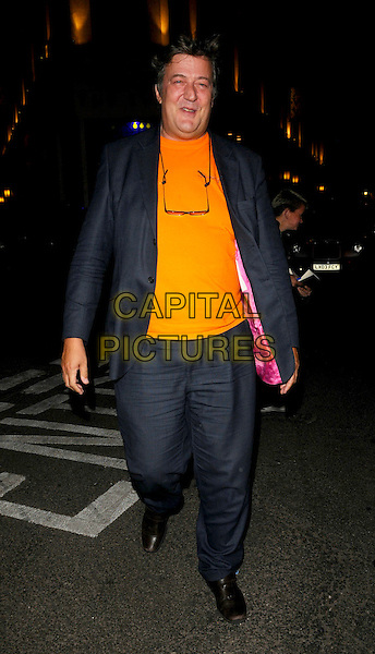 STEPHEN FRY.Spotted at The Ivy Restaurant, London, England..June 11th, 2008.full length blue suit jacket orange top .CAP/CAN.©Can Nguyen/Capital Pictures.