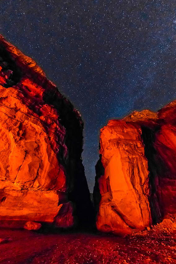 A starry sky over rock formations at night, Petra Archaeological Park, Petra, Jordan.