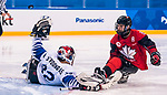 PyeongChang 15/3/2018 - Tyler McGregor (#8), of Forest, ON, gets one over the goalie but doesn't score as Canada takes on Korea in semifinal hockey action at the Gangneung Hockey Centre during the 2018 Winter Paralympic Games in Pyeongchang, Korea. Photo: Dave Holland/Canadian Paralympic Committee