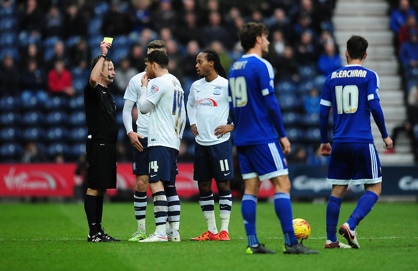 Preston North End's Joe Garner is shown a yellow card by Referee David Webb<br /> <br /> Photographer Chris Vaughan/CameraSport<br /> <br /> Football - The Football League Sky Bet Championship - Preston North End v Brentford - Saturday 23rd January 2016 -  Deepdale - Preston<br /> <br /> &copy; CameraSport - 43 Linden Ave. Countesthorpe. Leicester. England. LE8 5PG - Tel: +44 (0) 116 277 4147 - admin@camerasport.com - www.camerasport.com