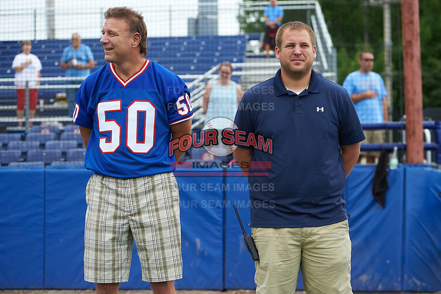 Former Buffalo Bills linebacker Ray Bentley with general manager Travis Sick during the national anthem before a Batavia Muckdogs game against the West Virginia Black Bears on August 21, 2016 at Dwyer Stadium in Batavia, New York.  West Virginia defeated Batavia 6-5. (Mike Janes/Four Seam Images)