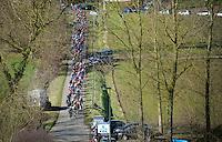 peloton entering the Haaghoek pav&eacute;<br /> <br /> Omloop Het Nieuwsblad 2015