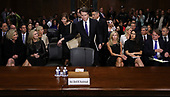 WASHINGTON, DC - SEPTEMBER 27:  Judge Brett Kavanaugh (C) holds hands with his wife Ashley Kavanaugh as he arrives to testify to the Senate Judiciary Committee during his Supreme Court confirmation hearing in the Dirksen Senate Office Building on Capitol Hill September 27, 2018 in Washington, DC. Kavanaugh was called back to testify about claims by Christine Blasey Ford, who has accused him of sexually assaulting her during a party in 1982 when they were high school students in suburban Maryland.  (Photo by Win McNamee/Getty Images)