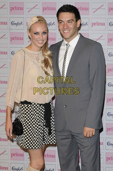 CAMILLA DALLERUP & KEVIN SACRE.Comfort Prima High Street Fashion Awards 2010 at Battersea Evolution, London, England, September 9th 2010 half length grey gray suit couple married husband wife black and white heart print skirt top cream blouse bag chain strap lace side ponytail hairband hair band beige lace top  .CAP/CAN.©Can Nguyen/Capital Pictures.