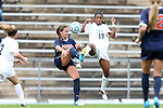 28 October 2012: UNC's Crystal Dunn (19) and Virginia's Danielle Colaprico (left) challenge for the ball. The University of North Carolina Tar Heels played the University of Virginia Cavaliers at Fetzer Field in Chapel Hill, North Carolina in a 2012 NCAA Division I Women's Soccer game. Virginia defeated UNC 1-0 in their Atlantic Coast Conference quarterfinal match.