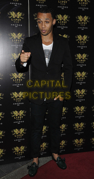 Aston Merrygold of JLS<br /> The Lipsy VIP Fashion Awards 2013, DSTRKT, Rupert St., London, England.<br /> May 29th, 2013<br /> full length black white suit top hand finger pointing green loafers shoes <br /> CAP/CAN<br /> &copy;Can Nguyen/Capital Pictures