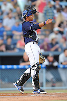 Asheville Tourists catcher Jose Briceno #4 during opening night game against the Delmarva Shorebirds at McCormick Field on April 3, 2014 in Asheville, North Carolina. The Tourists defeated the Shorebirds 8-3. (Tony Farlow/Four Seam Images)
