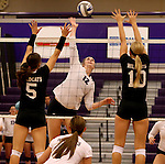 SIOUX FALLS, SD - SEPTEMBER 23: Michelle Ritland #12 from University of Sioux Falls looks to get a kill between Michaela Mestl #5 and Alyssa Frauendorfer #10 from Wayne State Tuesday night at the Stewart Center.  (Photo by Dave Eggen/Inertia)