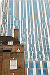 Nido student accomodation towering over traditional east London housing estate. Brune estate London E1