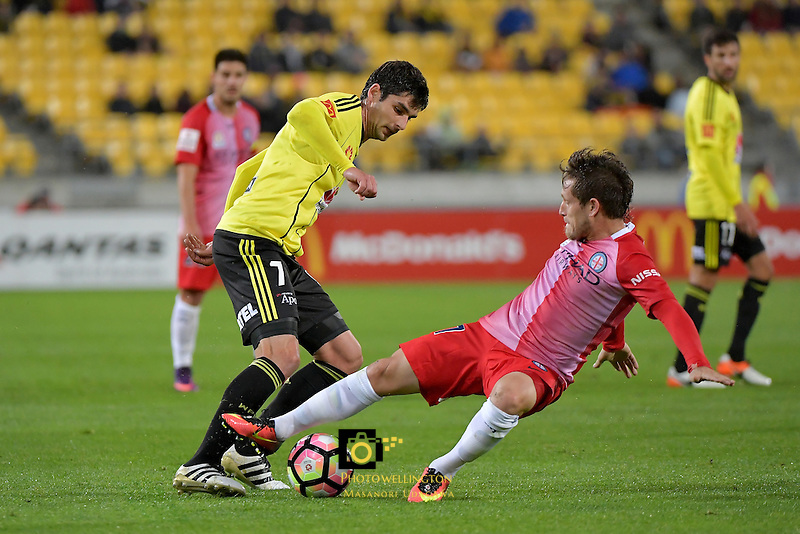 Wellington Phoenix&rsquo;  Guilherme Finkler and Melbourne City FC's Fernando Brandon in action during the A League - Wellington Phoenix v Melbourne City FC at Westpac Stadium, Wellington, New Zealand on Saturday 8 October 2016.<br /> Photo by Masanori Udagawa. <br /> www.photowellington.photoshelter.com.