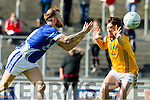 Barry John Keane KOR in action against David Foran Feale Rangers in the  Kerry County Football Championship on Saturday.