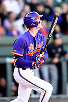 Third baseman Patrick Cromwell (25) of the Clemson Tigers bats in the Reedy River Rivalry game against the South Carolina Gamecocks on Saturday, March 3, 2018, at Fluor Field at the West End in Greenville, South Carolina. Clemson won, 5-1. (Tom Priddy/Four Seam Images)