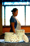 Large tortillas are stacked for eating in a coffee farm kitchen in western El Salvador.