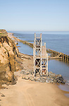 Former beach access stairs now stand alone as coastal erosion continues, Happisburgh, Norfolk, England