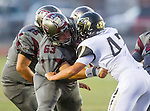 Torrance, CA 09/19/15 - James Kozachenko (Peninsula #42) and Tony Dacosta (Torrance #63) in action during the Peninsula Panthers - Torrance Tartars Varsity football game at Torrance High School