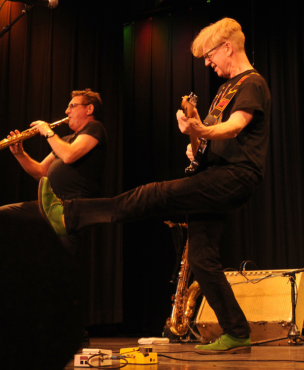 Left to right:  Geoff Blythe (Saxophone), and Larry Kirwan (Vocals, Stratocaster), jamming during a performance at the Boulton Center in Bay Shore, Long Island, on Friday, March 4, 2011. Photograph by Jim Peppler. Copyright Jim Peppler/2011.