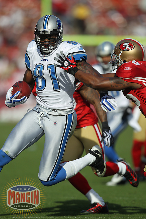 SAN FRANCISCO - DECEMBER 27:  Wide receiver Calvin Johnson #81 of the Detroit Lions runs with the football against the San Francisco 49ers during the game at Candlestick Park on December 27, 2009 in San Francisco, California. The 49ers beat the Lions 20-6. Photo by Brad Mangin
