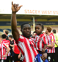 Lincoln City's John Akinde applauds the fans at the final whistle after securing the League 2 Title<br /> <br /> Photographer Andrew Vaughan/CameraSport<br /> <br /> The EFL Sky Bet League Two - Lincoln City v Tranmere Rovers - Monday 22nd April 2019 - Sincil Bank - Lincoln<br /> <br /> World Copyright © 2019 CameraSport. All rights reserved. 43 Linden Ave. Countesthorpe. Leicester. England. LE8 5PG - Tel: +44 (0) 116 277 4147 - admin@camerasport.com - www.camerasport.com