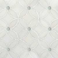 Esferitas, a handmade mosaic shown in honed Paperwhite, tumbled Thassos and Tropical White Serenity glass, is part of the Parterre Collection by Paul Schatz for New Ravenna.