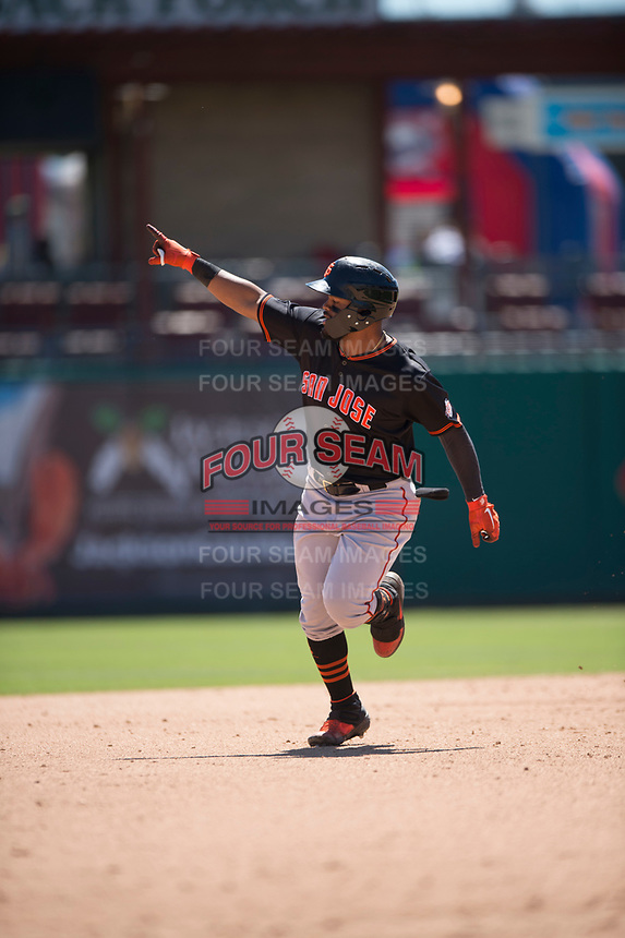 San Jose Giants center fielder Heliot Ramos (13) points to the bullpen after hitting a home run during a California League game against the Stockton Ports on April 9, 2019 in Stockton, California. San Jose defeated Stockton 4-3. (Zachary Lucy/Four Seam Images)
