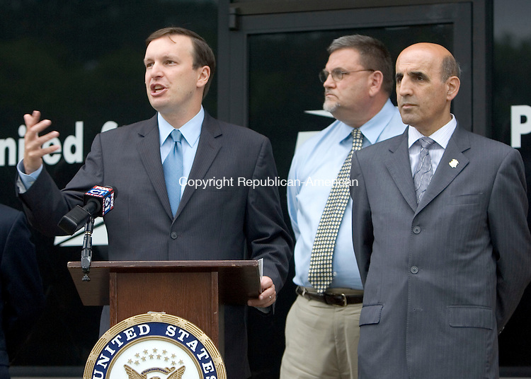 WATERBURY, CT. 25 August 2011-082511SV04--From left, U.S. Rep. Chris Murphy, D-5th, John H. Dirzius, American Postal Workers Union, and State Rep. Selim Noujaim, R-74, hold a press conference at the Post Office on Manor Avenue in Waterbury Thursday. They were there to discuss local impacts of post office closures and layoffs.<br /> Steven Valenti Republican-American