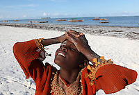 A child is photographed on the beach in Matwemwe, Zanzibar.