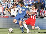 Getafe's Daniel Parejo against Almeria's Miguel Garcia Corona during La Liga Match. May 07, 2011. (ALTERPHOTOS/Alvaro Hernandez)
