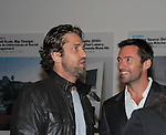 Gerard Butler and Hugh Jackman in support of the launch of the Global Poverty Project's 1.4 Billion Reasons DVD on October 20. 2010 at New York City's Museum of Modern Art, NYC, NY. (Photo by Sue Coflin/Max Photos)