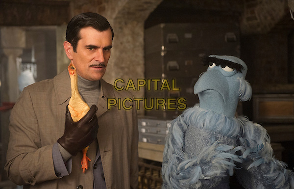 Ty Burrell &amp; SAM EAGLE (voice of Eric Jacobson)<br /> in Muppets Most Wanted (2014) <br /> *Filmstill - Editorial Use Only*<br /> CAP/NFS<br /> Image supplied by Capital Pictures