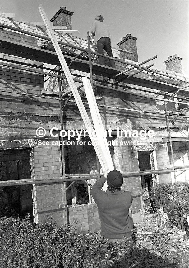 Roman Catholics are rebuilding and making habitable again houses at Farringdon Gardens, Ardoyne, Belfast, which were evacuated and in many cases set on fire by fleeing Protestants who left the area following post-Internment rioting. Date that photos were taken is uncertain but probably 3 or 4 months after the rioting in August 1971. 426/71, 197111000426c..Copyright Image from Victor Patterson, 54 Dorchester Park, Belfast, UK, BT9 6RJ..Tel: +44 28 9066 1296.Mob: +44 7802 353836.Voicemail +44 20 8816 7153.Skype: victorpattersonbelfast.Email: victorpatterson@mac.com.Email: victorpatterson@ireland.com (back-up)..IMPORTANT: If you wish to use this image or any other of my images please go to www.victorpatterson.com and click on the Terms & Conditions. Then contact me by email or phone with the reference number(s) of the image(s) concerned.