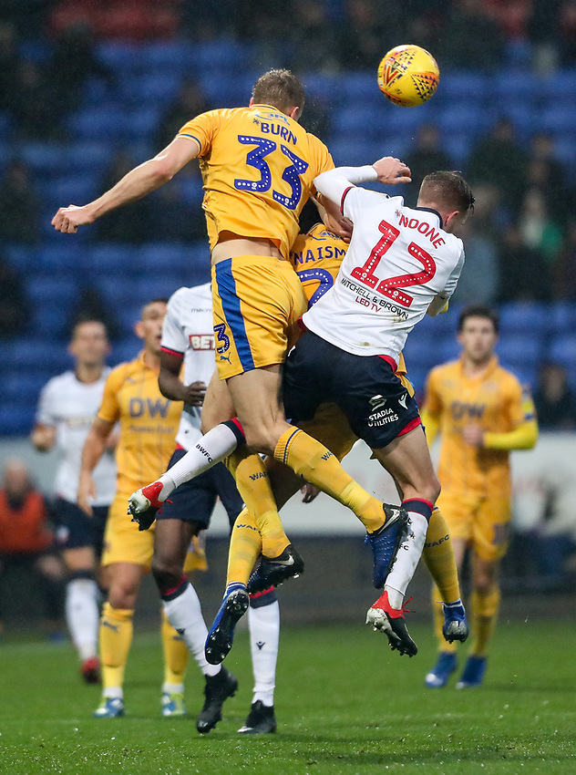Bolton Wanderers' Craig Noone competing with Wigan Athletic's Dan Burn<br /> <br /> Photographer Andrew Kearns/CameraSport<br /> <br /> The EFL Sky Bet Championship - Bolton Wanderers v Wigan Athletic - Saturday 1st December 2018 - University of Bolton Stadium - Bolton<br /> <br /> World Copyright © 2018 CameraSport. All rights reserved. 43 Linden Ave. Countesthorpe. Leicester. England. LE8 5PG - Tel: +44 (0) 116 277 4147 - admin@camerasport.com - www.camerasport.com