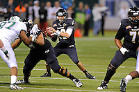 20 December 2011:  FIU quarterback Wesley Carroll (13) looks for a receiver downfield in the first quarter as the Marshall University Thundering Herd defeated the FIU Golden Panthers, 20-10, to win the Beef 'O'Brady's St. Petersburg Bowl at Tropicana Field in St. Petersburg, Florida.