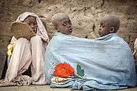 Children memorize the Koran (Qur'an) on tablets in the early morning at a Koranic School in Timbuktu. /Felix Features