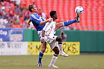 July 14 2007:  Jimmy Conrad (foot extended) of the Wizards beats Robbie Findley (front) of Real Salt Lake to the ball.  The MLS Kansas City Wizards defeated the visiting Real Salt Lake 1-0 at Arrowhead Stadium in Kansas City, Missouri, in a regular season league soccer match.