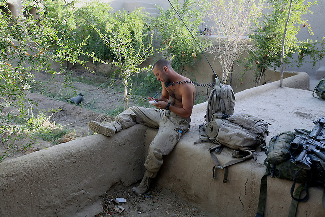 A Canadian soldier with the Royal 22nd Regiment jots down a radio message at a new outpost that has just been established in the village of Zalakhan in Kandahar province, Afghanistan. The soldiers moved into the village to stop Taliban fighters from shooting mortars at a nearby base. Aug. 6, 2009. DREW BROWN/STARS AND STRIPES