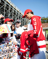 Roger Federer (SUI) signs autographs after his match  against Bernard Tomic (AUS) in the Fourth Rubber. Roger Federer beat Bernard Tomic  6-2 7-5 3-6 6-3...Tennis - Davis Cup - World Group - Royal Sydney Golf Club - Sydney - Day 3 - Sunday September 18th 2011..© AMN Images, Barry House, 20-22 Worple Road, London, SW19 4DH, UK..+44 208 947 0100.www.amnimages.photoshelter.com.www.advantagemedianetwork.com.