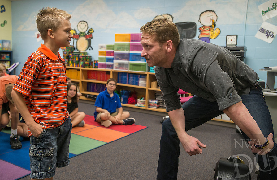 """NWA Democrat-Gazette/ANTHONY REYES • @NWATONYR<br /> Barrett Baber, of Fayetteville, talks with Aramis Hall, 9, fourth grader at Vandergriff Elementary School, Wednesday, Sept. 23, 2015 after Barber worked with a combined fourth grade choir at the school in Fayetteville. Baber is a contestant on the NBC show """"The Voice."""" Baber is working with the students on a song he co-wrote, """"A.R.K.A.N.S.A.S. (Get there from here)"""" that won a contest with the Arkansas Department of Parks and Tourism. The choir and Barber will have a special performance for the school on Oct. 5 and a public performance the same day at 6:30 p.m. in the Vandergriff gym."""