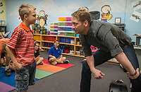 NWA Democrat-Gazette/ANTHONY REYES &bull; @NWATONYR<br /> Barrett Baber, of Fayetteville, talks with Aramis Hall, 9, fourth grader at Vandergriff Elementary School, Wednesday, Sept. 23, 2015 after Barber worked with a combined fourth grade choir at the school in Fayetteville. Baber is a contestant on the NBC show &quot;The Voice.&quot; Baber is working with the students on a song he co-wrote, &quot;A.R.K.A.N.S.A.S. (Get there from here)&quot; that won a contest with the Arkansas Department of Parks and Tourism. The choir and Barber will have a special performance for the school on Oct. 5 and a public performance the same day at 6:30 p.m. in the Vandergriff gym.