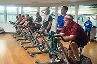 NWA Democrat-Gazette/BEN GOFF @NWABENGOFF<br /> Competitors bike Saturday, March 10, 2018, while competing in the 2018 Indoor Triathlon at the Jones Center in Springdale. Participants started in waves and had 10 minutes to swim, 20 minutes on a stationary bike and 15 minutes on a treadmill to log as many miles as possible.