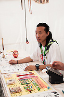 Japanese behinde the desk at the Japan foodhouse is ready to service the costumer. Photo: Audun Ingebrigtsen / Scouterna