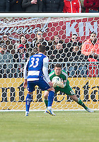 06 April 2013: Toronto FC goalkeeper Joe Bendik #12 makes a save as FC Dallas forward Kenny Cooper #33 waits for a rebound during an MLS game between FC Dallas and Toronto FC at BMO Field in Toronto, Ontario Canada..The game ended in a 2-2 draw..