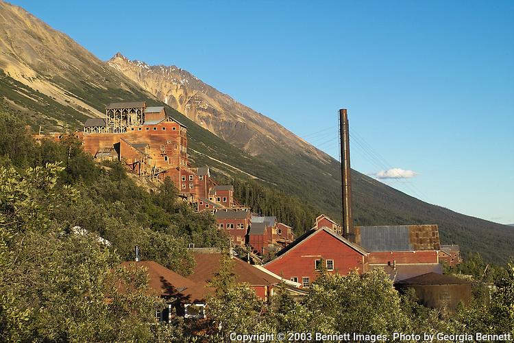 The setting July sun illuminates the buildings at Kennicott Mine.