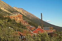 The setting July sun illuminates the buildings at Kennicott Mine.