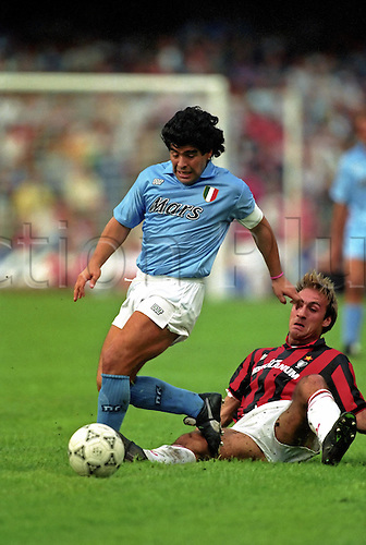 21 October 1990: Diego Maradona, full length wit hthe ball during the Serie A game between Napoli and AC Milan. The game finished in a 1-1 draw Photo: Mike Hewitt/Action Plus<br /> <br /> <br /> soccer football 901021 player