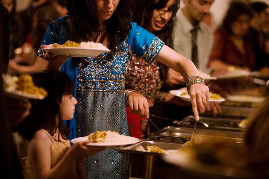 Guests line up for a banquet dinner in traditional garments during an engagement party, at the Diamond Palace, in Fremont, Ca., on Saturday, March 7, 2009.